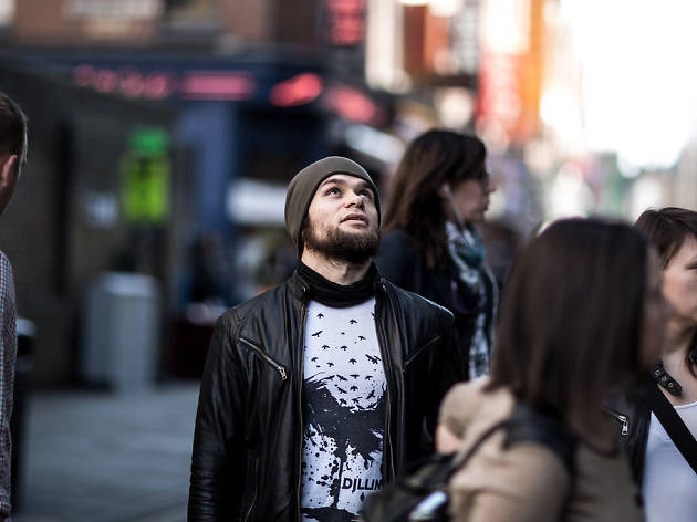 A man looks to the heavens on Brick Lane.