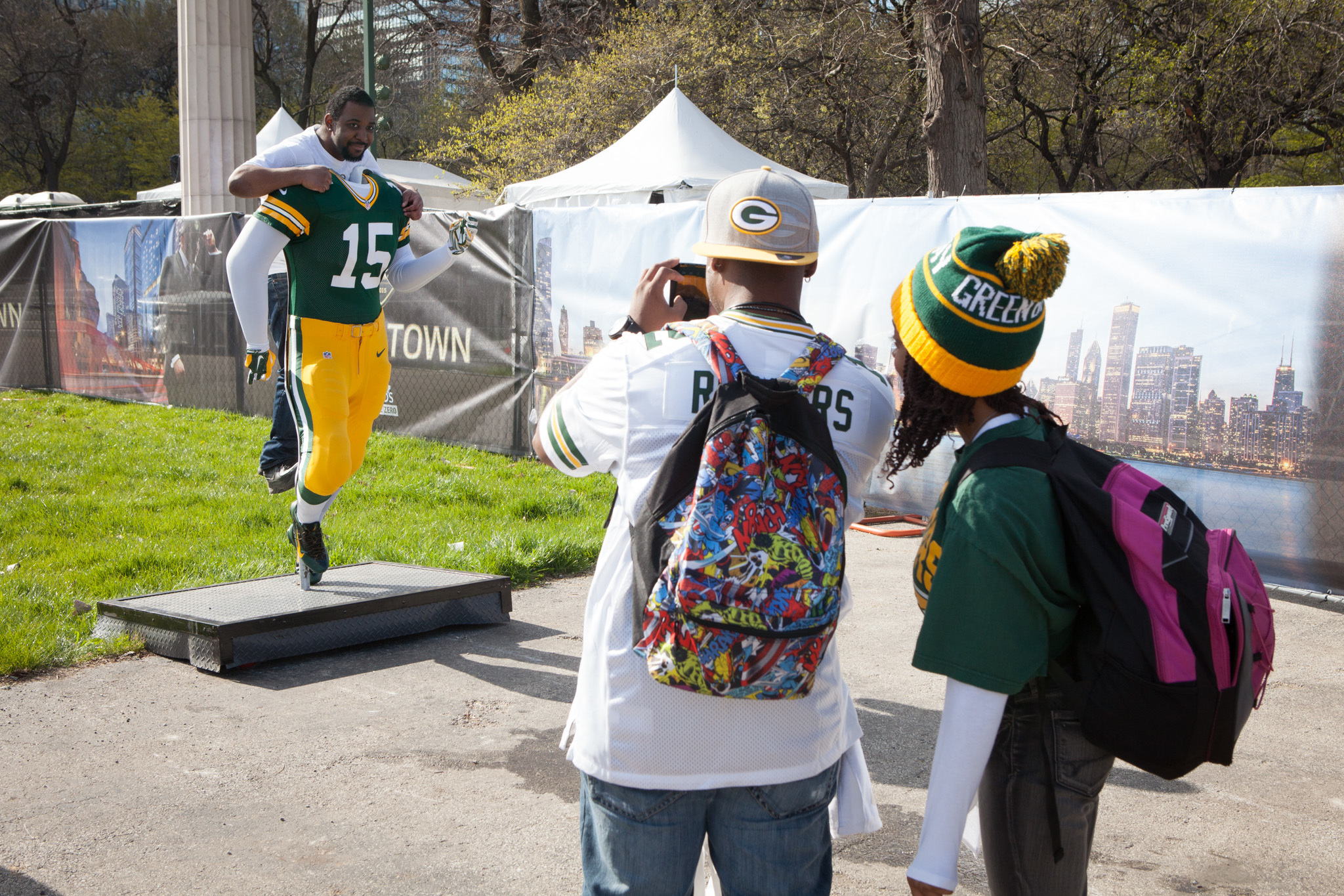 Football fans show off their team spirit in Grant Park at NFL Draft Town, April 30, 2015.