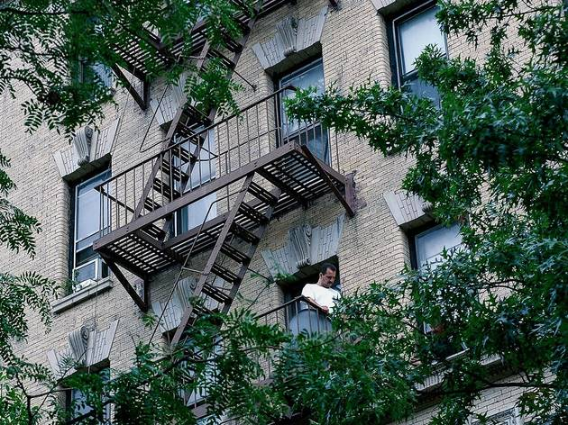 Man on the fire escapes, Harlem (NYC)