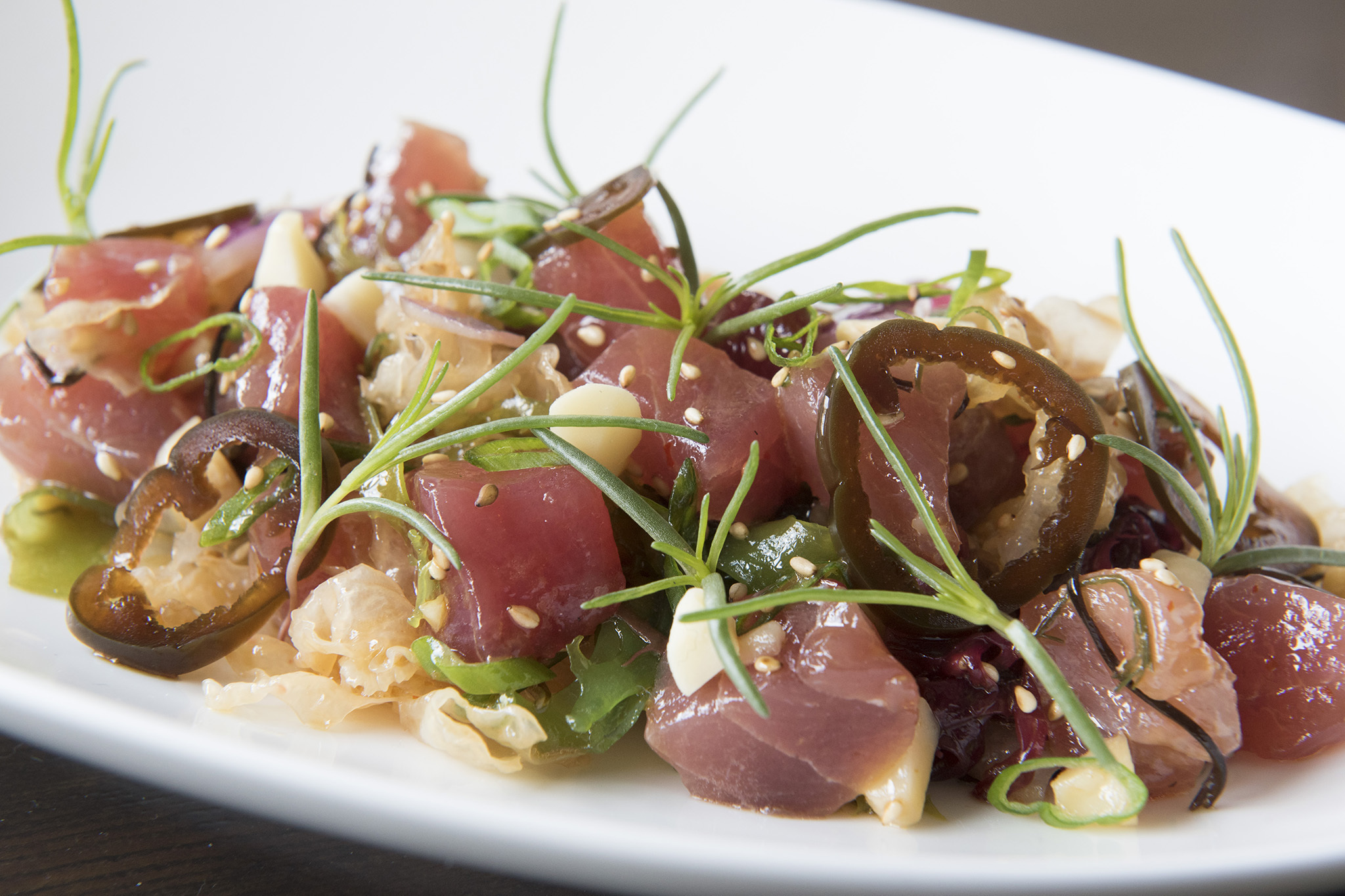 big-eye tuna poke, macadamia nuts, pickled jalapeño, seawead