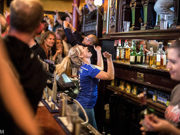 Chelsea fans in a pub celebrate a 1-0 victory over Crystal Palace.