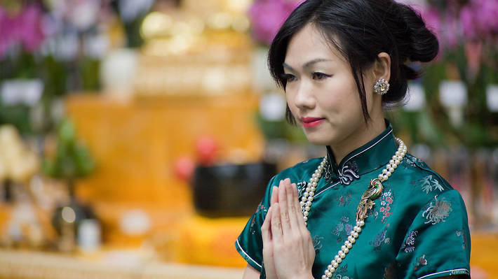 A woman participates in the Buddha's Birthday celebrations in Leicester Square.