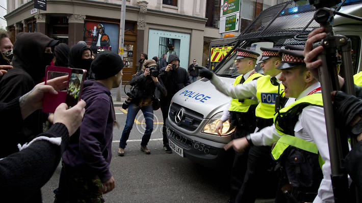 Protestors and police face off during a May Day protest.