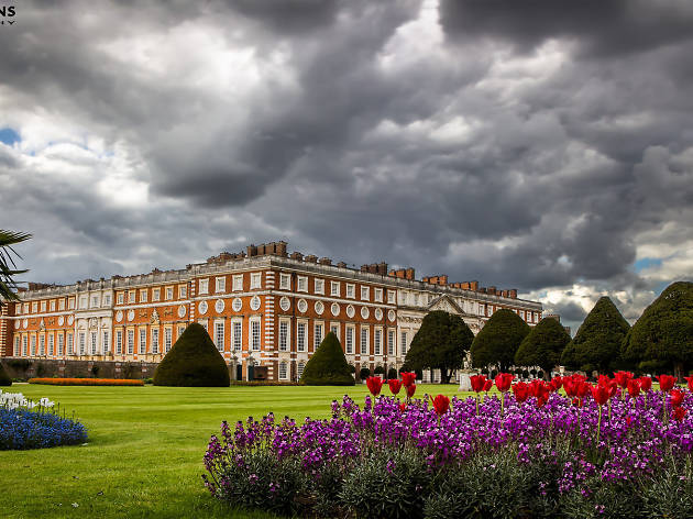 Dark clouds above flower beds at Hampton Court Palace