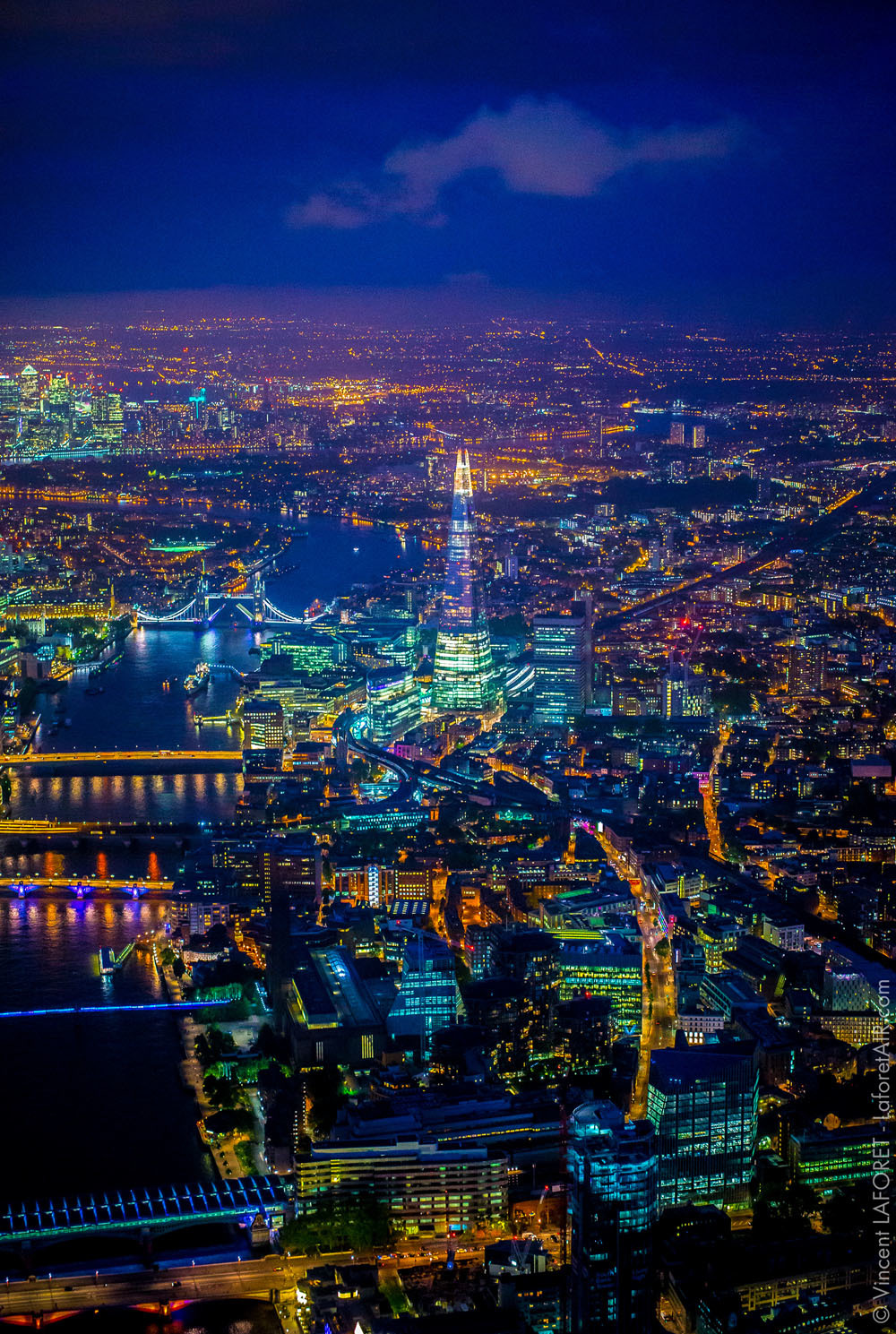 Aerial photo of the Shard and Thames at night.