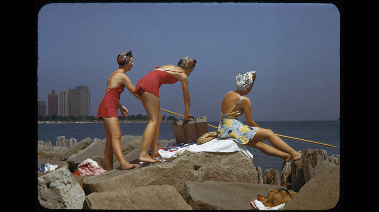 Sunbathers with a fishing pole and suitcase at Promontory Point, July 18,1942.