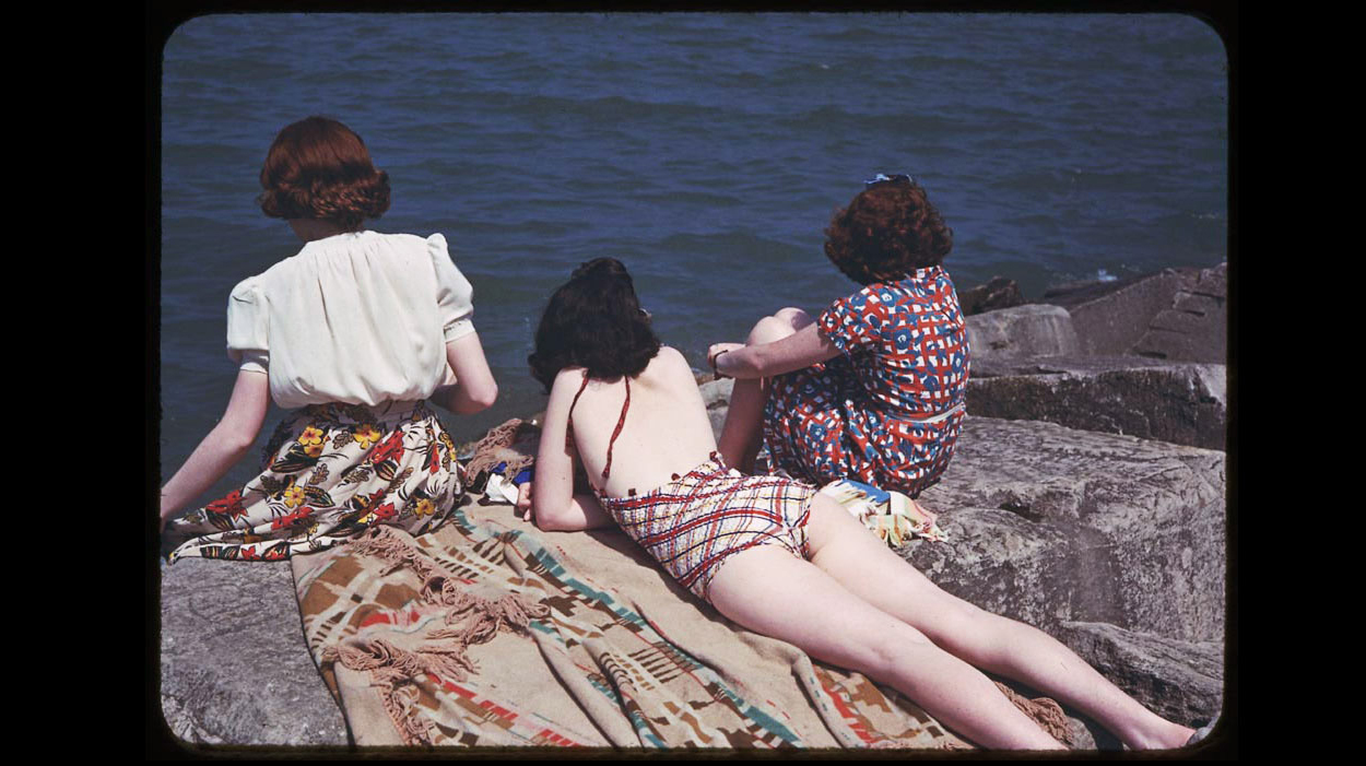Three girls sit on the rocks at Jackson Park near 67th St. July 1941.