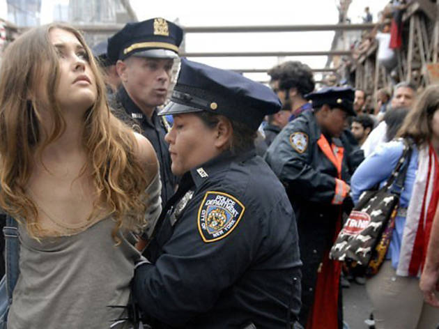 Stephanie Keith, Police arrest a protester on New York's Brooklyn Bridge on Saturday, Oct. 1, 2011, during a march by Occupy Wall Street