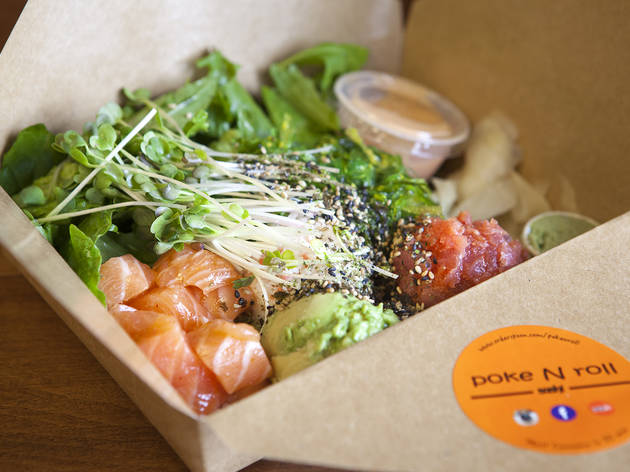 Salmon and spicy tuna with avocado, seaweed salad and sprouts at