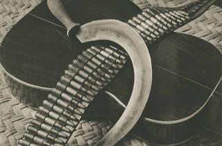 'Sickle, Bandolier & Guitar'. ca. 1927