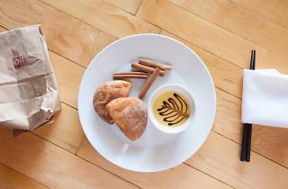 Oiistar serves a bao doughnut.