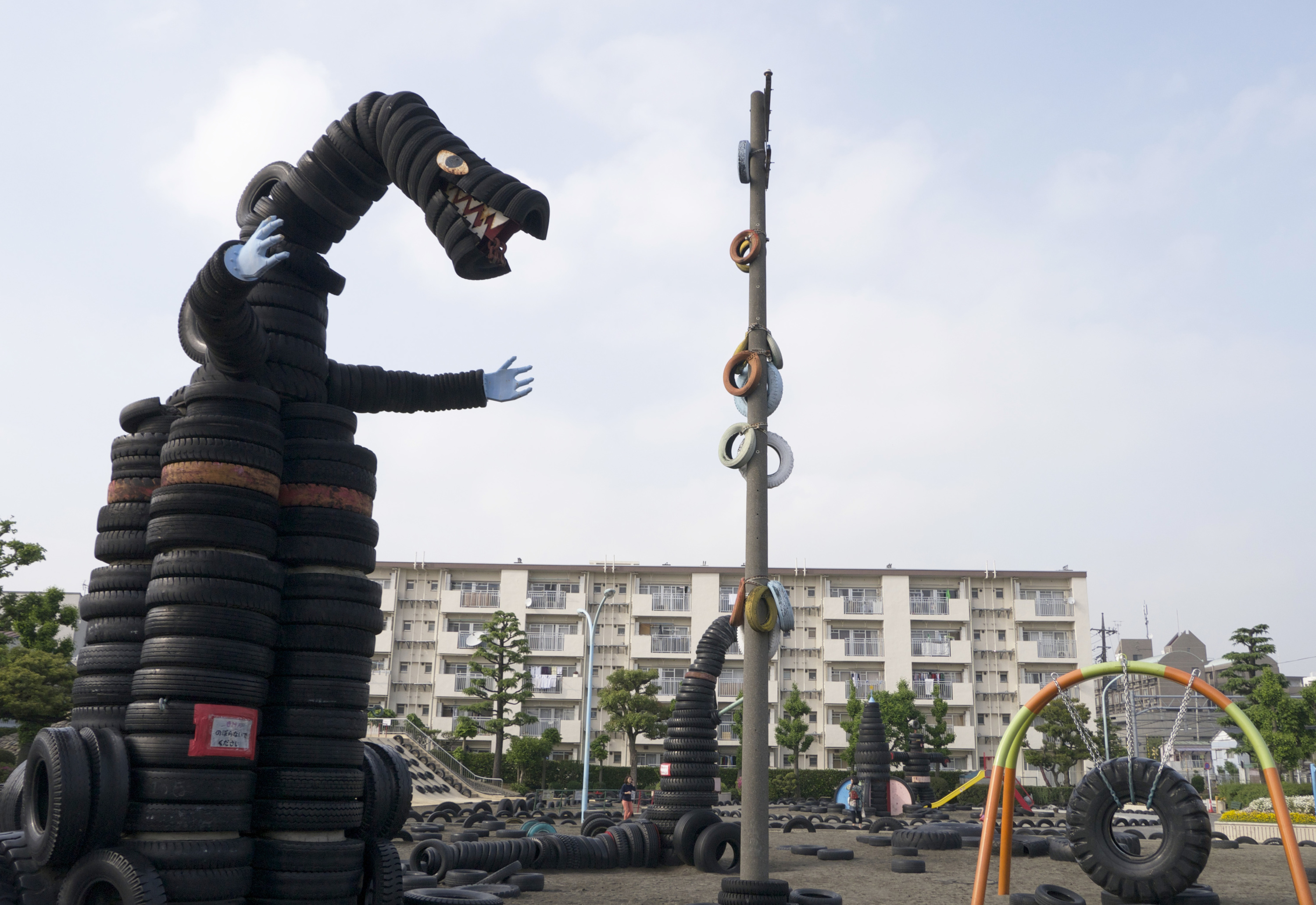Take a breather with Godzilla at Tire Park