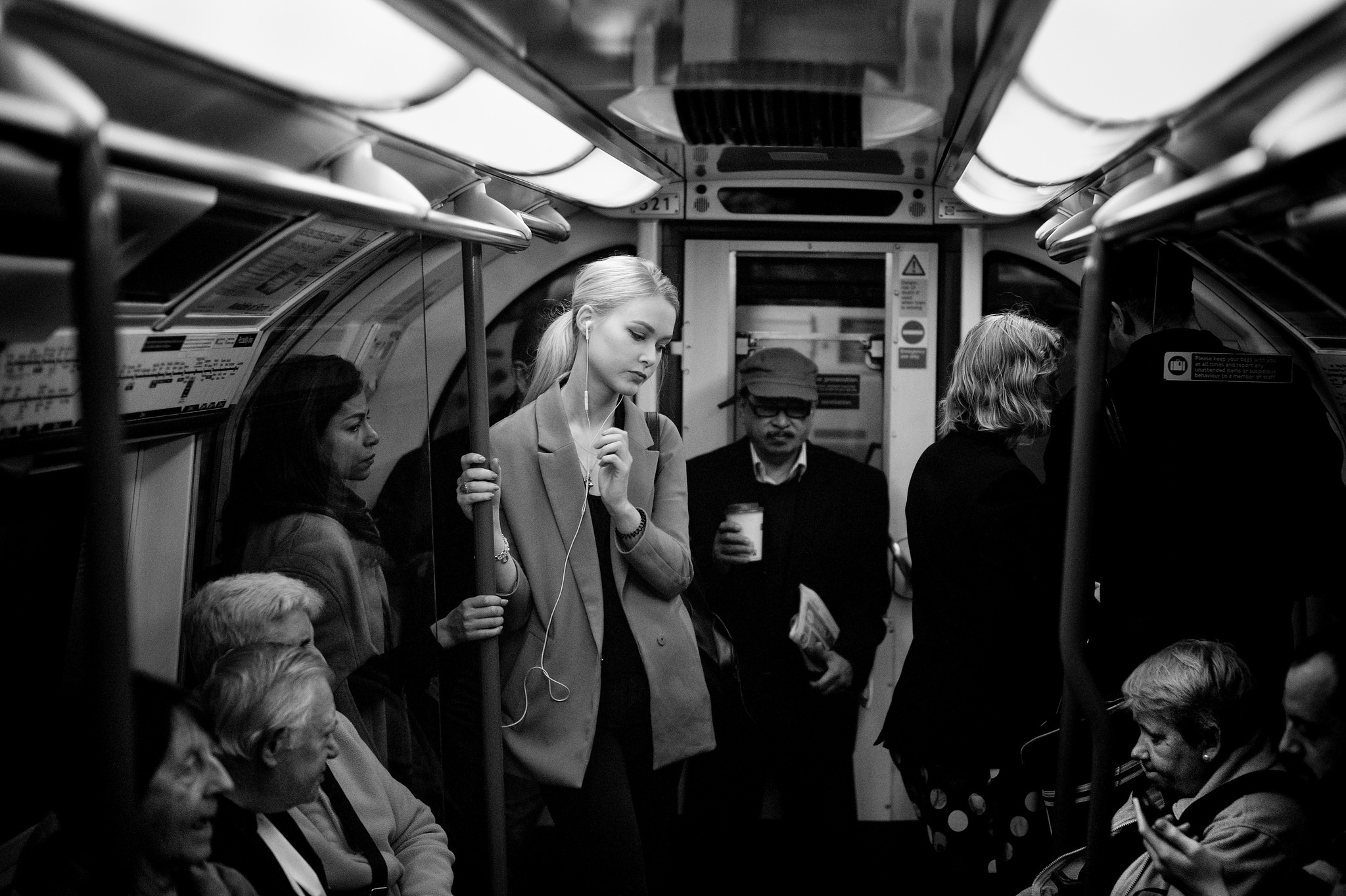 Black and white photo of a woman on the Tube.