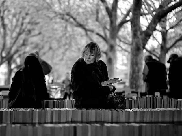 A woman shopping for books on the Southbank.