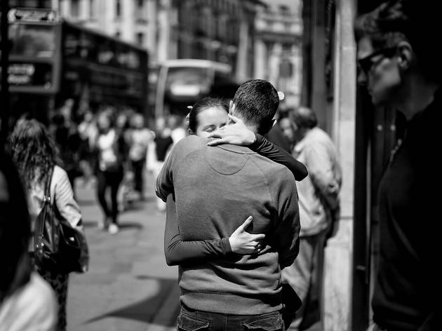 A couple embrace in London.
