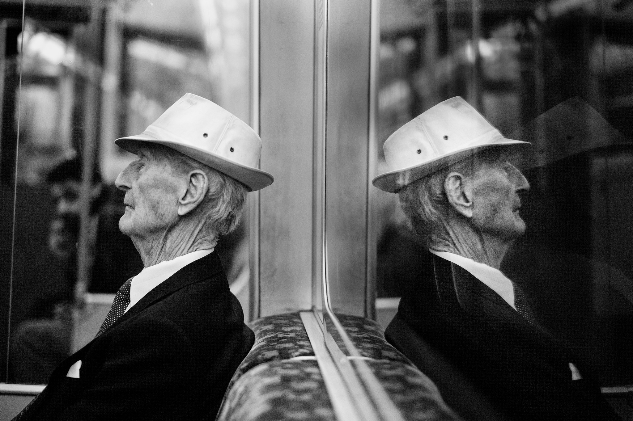 An older gentleman rides the Tube.