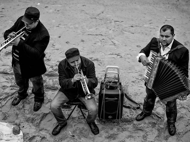 A band play on the foreshore of the Thames.