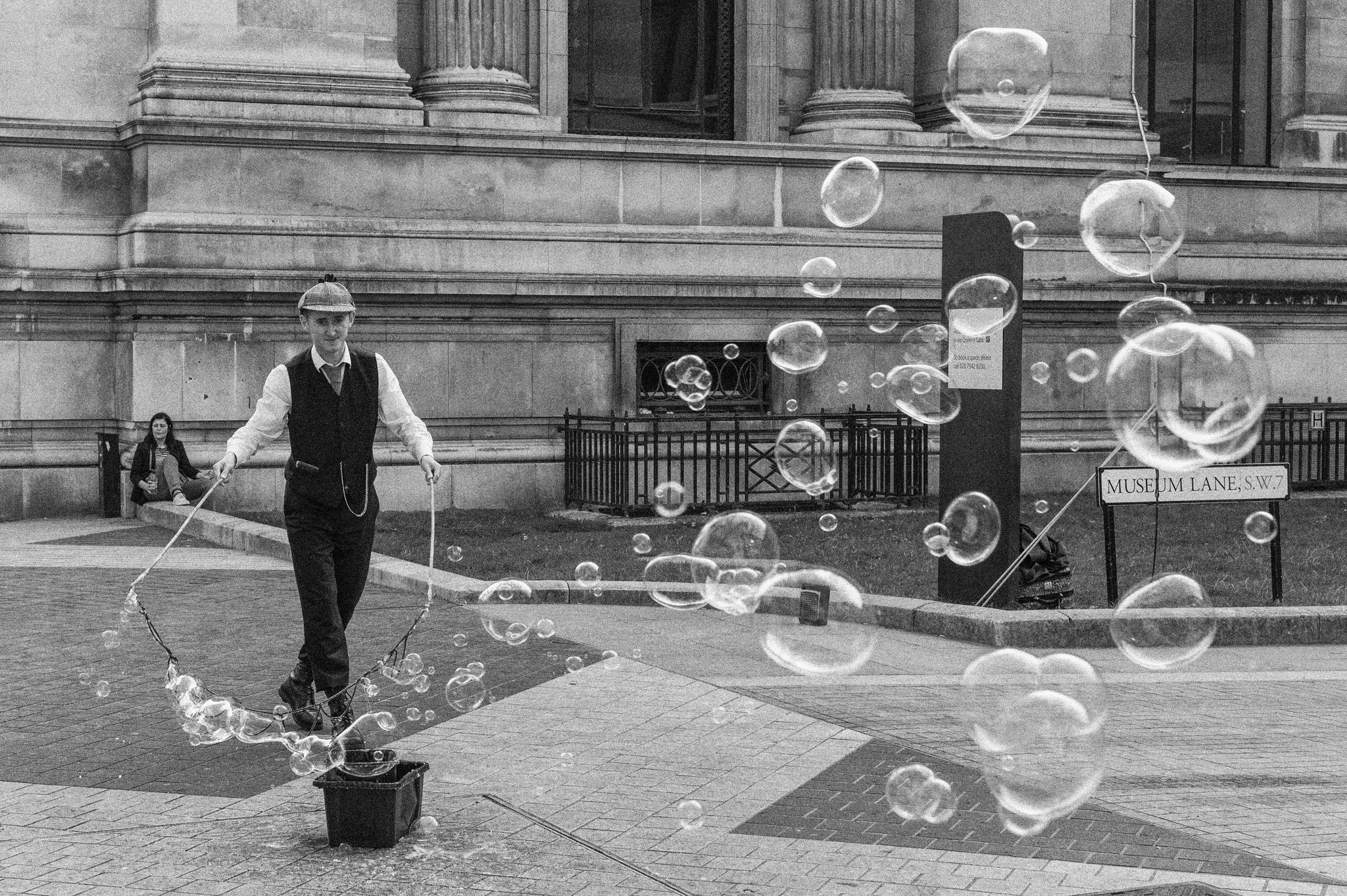 A street entertainer blows bubbles outside the British Museum.