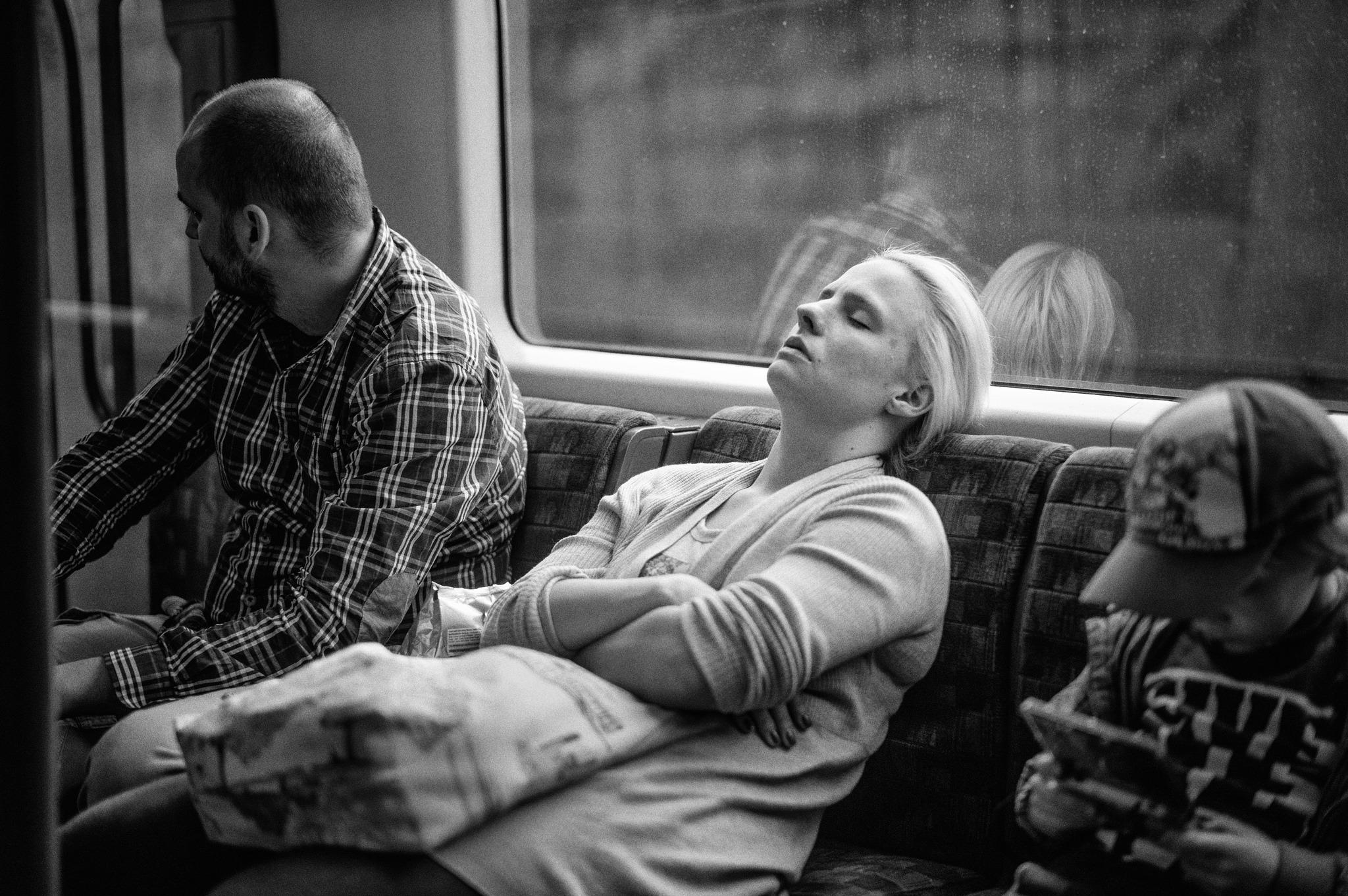 A woman asleep on the tube.