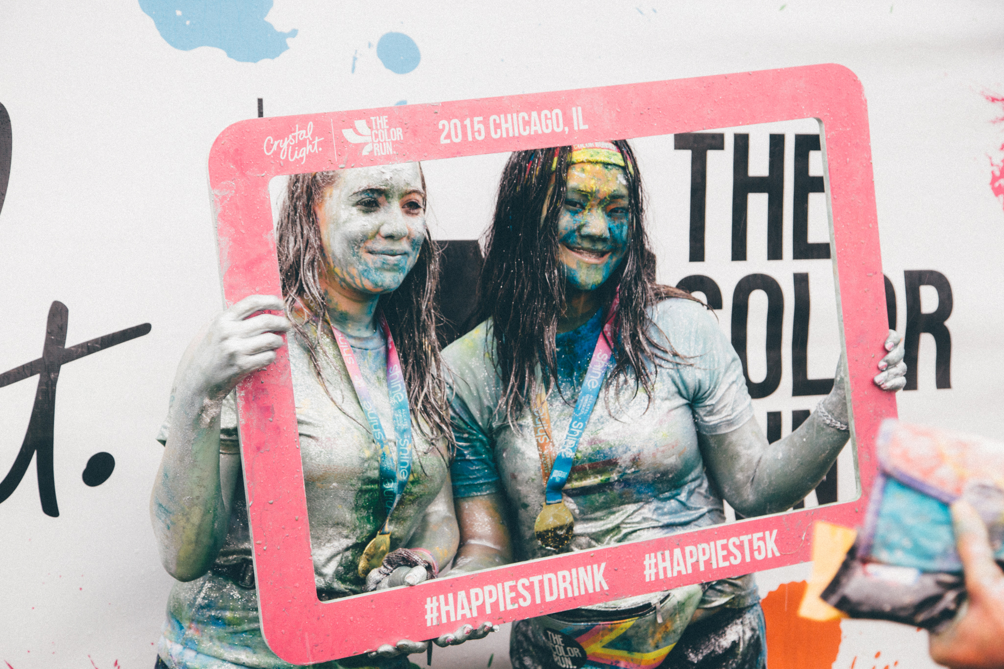 Runners get blasted with rainbow cornstarch at the Color Run 5K through Grant Park on June 7, 2015.