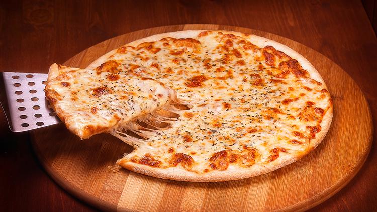 Croquer une pizza dans le Bronx