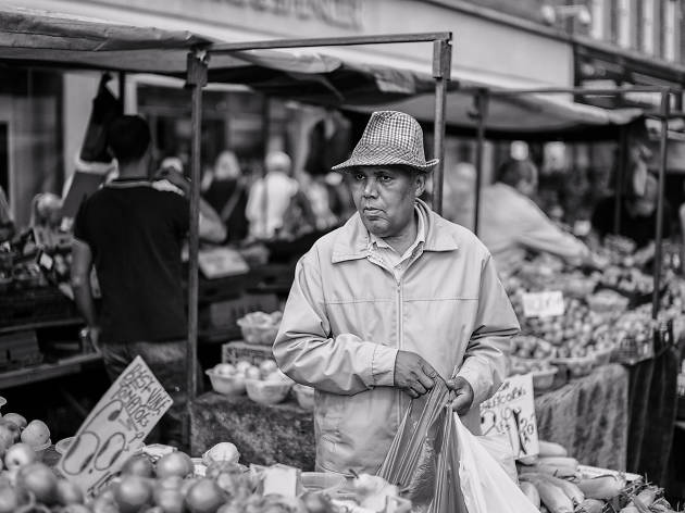 A man shopping for groceries at a market.