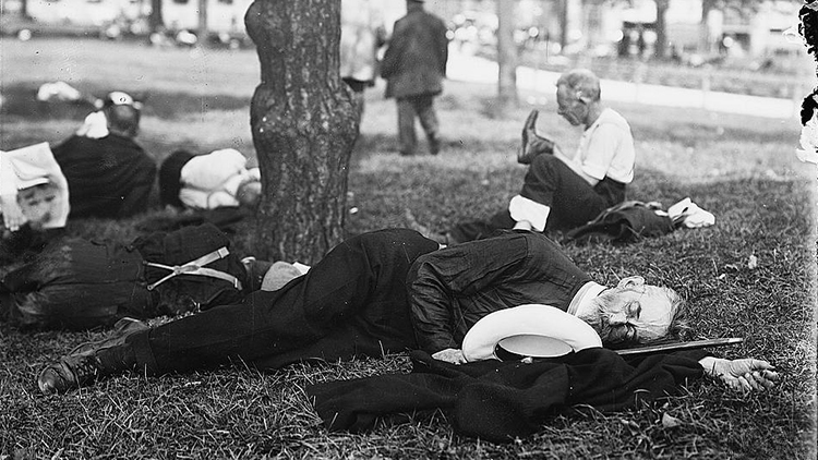 1915, Asleep in Battery Park on hot day