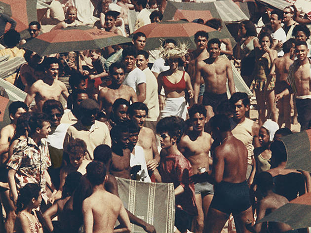 Circa 1961-1963, sunbathers and swimmers on Coney Island