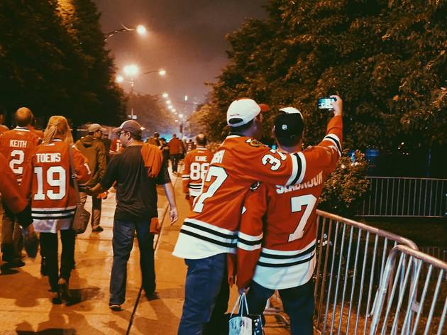 Blackhawks fans celebrate the team's Stanley Cup win over Tampa Bay outside the United Center on June 15, 2015