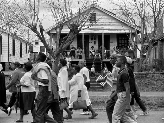Selma marchers passing by house with people, negro and white