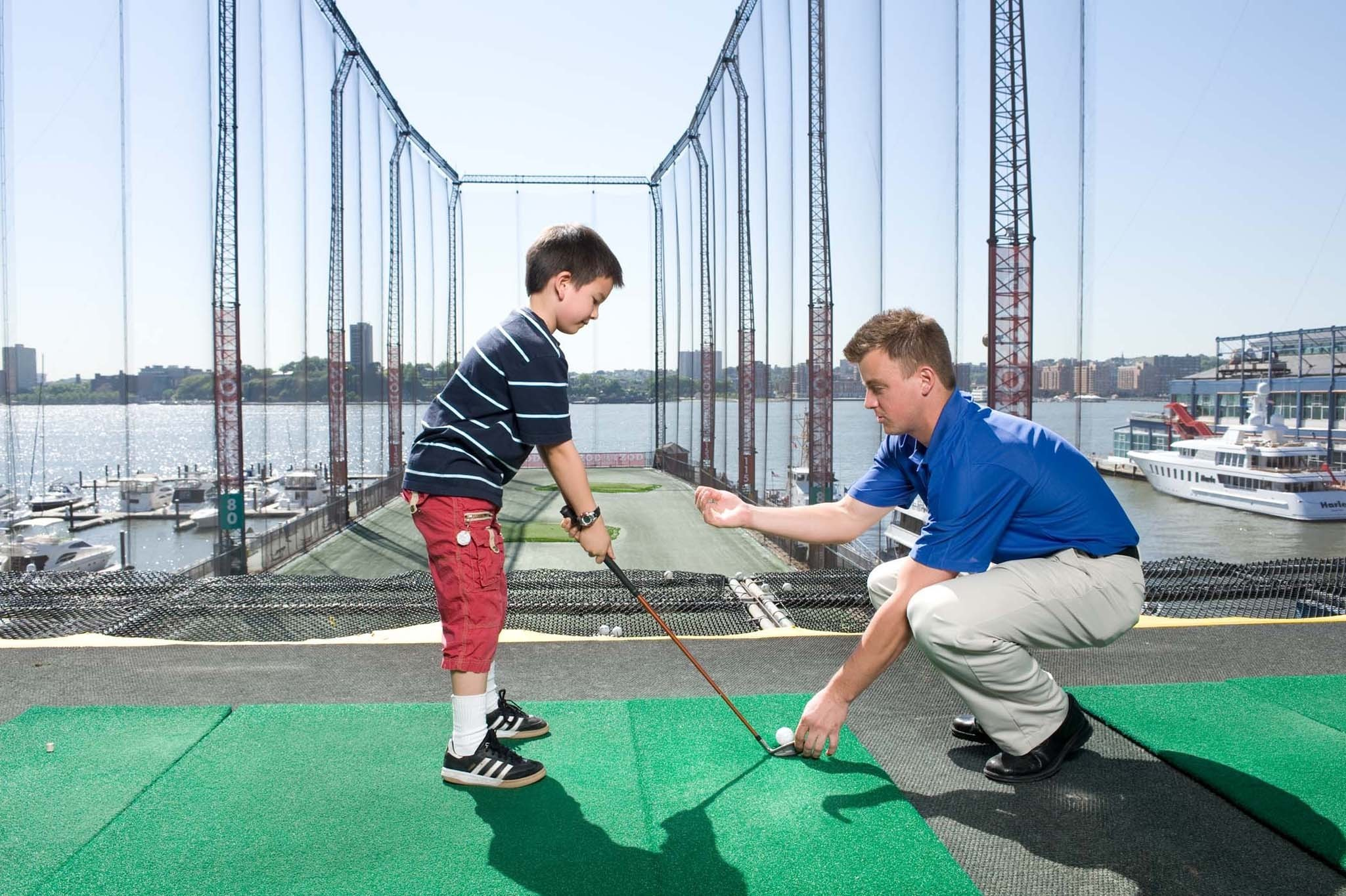 Take a swing at The Golf Club at Chelsea Piers