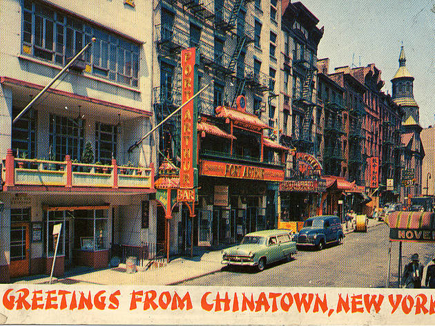 """Greetings from Chinatown, New York"" postcard, ca. 1940s. The image is of Mott Street, facing north. Port Arthur Restaurant is at the center, with..."