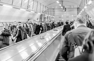 A busy escalator on the Tube.