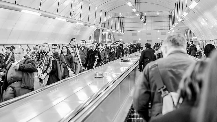 A busy escalator on the Tube.