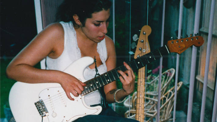 Amy playing guitar - Amy Winehouse documentary