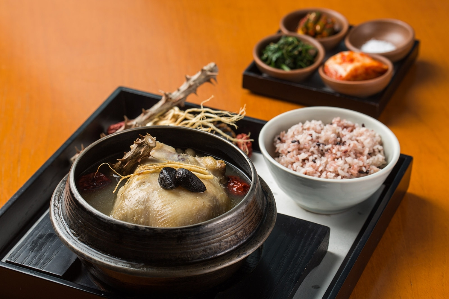 Black garlic samgyetang (Korean ginseng chicken soup) at Park Hyatt Seoul's The Lounge