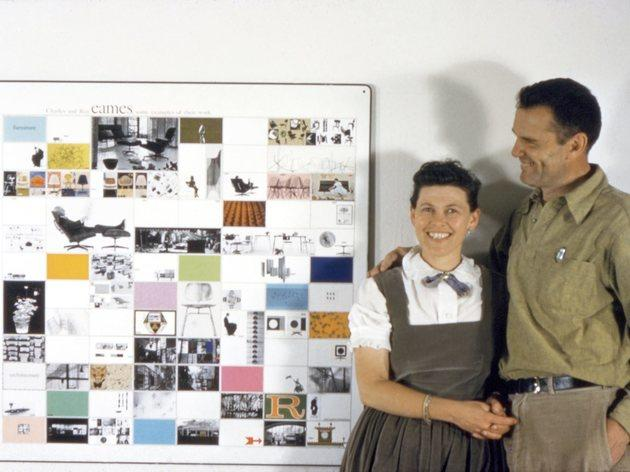(Charles and Ray Eames with a panel of Eames Office work made for the American Institute of Architects, 1957. © Eames Office LLC.)