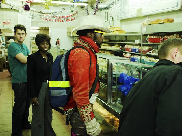An urban cowboy queues up for a beigel on Brick Lane, London.