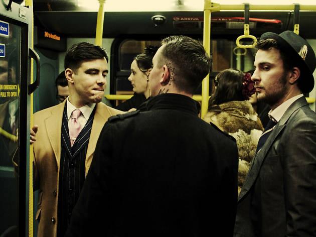 Three friends on a bus.
