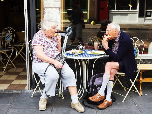 A couple enjoy a sandwich at an east London café.