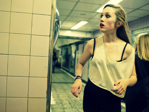 A girl runs for the last tube of the day at Old Street station, east London.