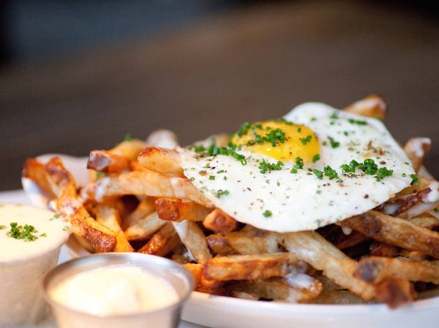 Crispy Fries with Mornay Sauce, Garlic Aioli & Fried Farm Egg at Au Cheval ($9.95)
