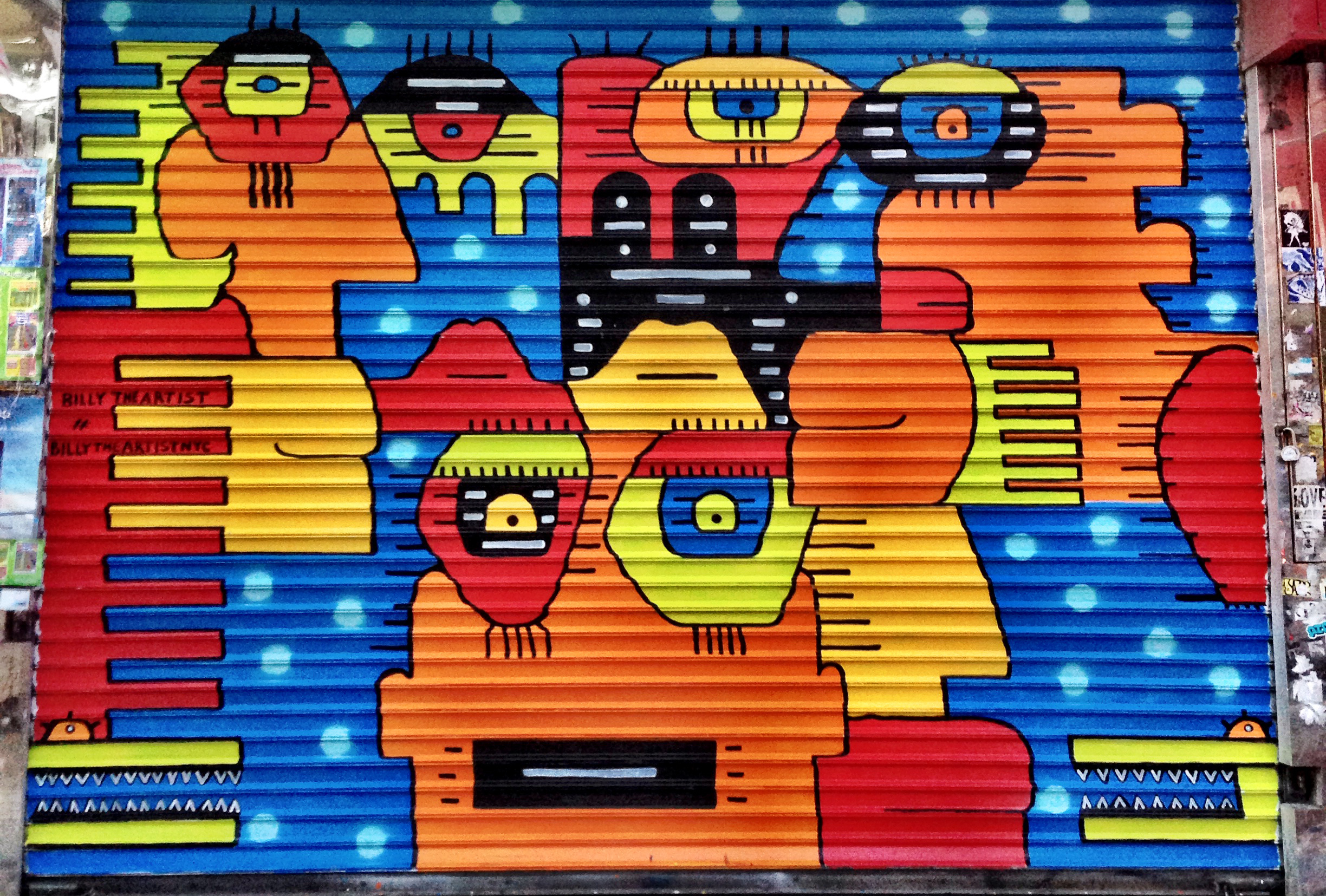 See street-art on storefront security gates that are completely legal
