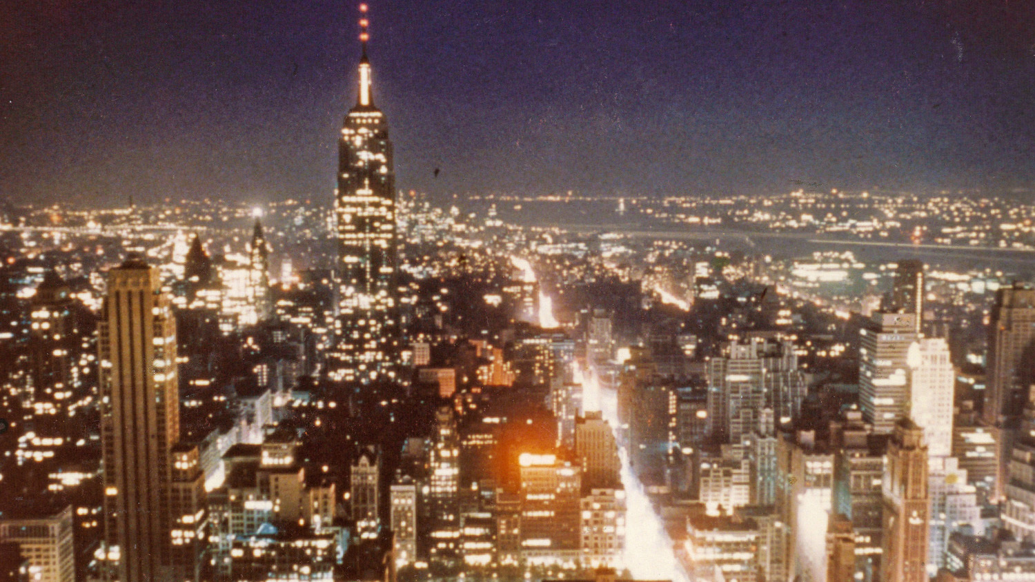 Empire State Building and Manhattan lights at night, 1952