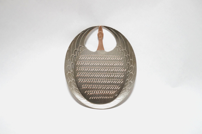 Crane-shaped copper grater