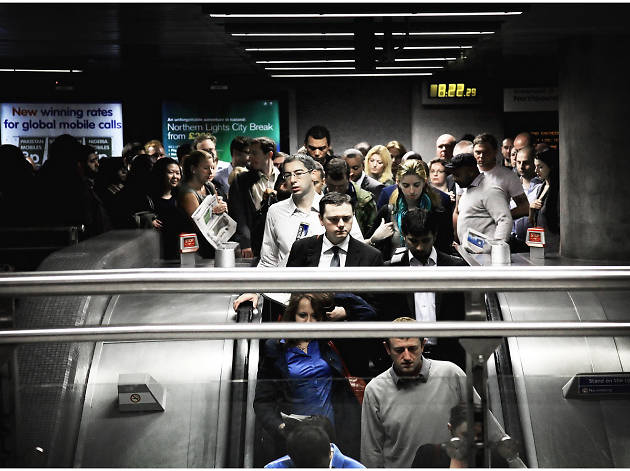 Commuters at Canada Water Underground station, London.