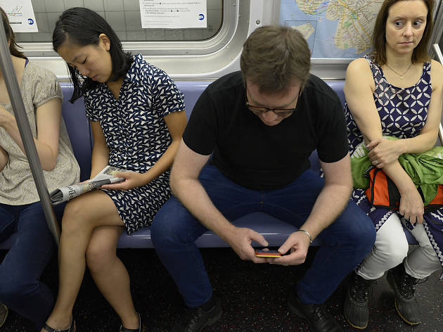 Woman Gives Side Eye to Manspreading