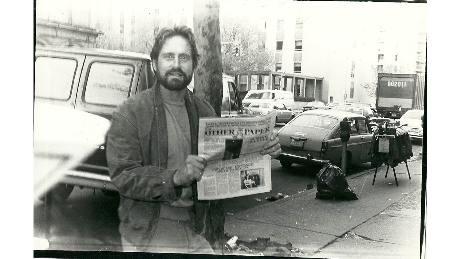 Michael Douglas holding The Other Paper, 1980