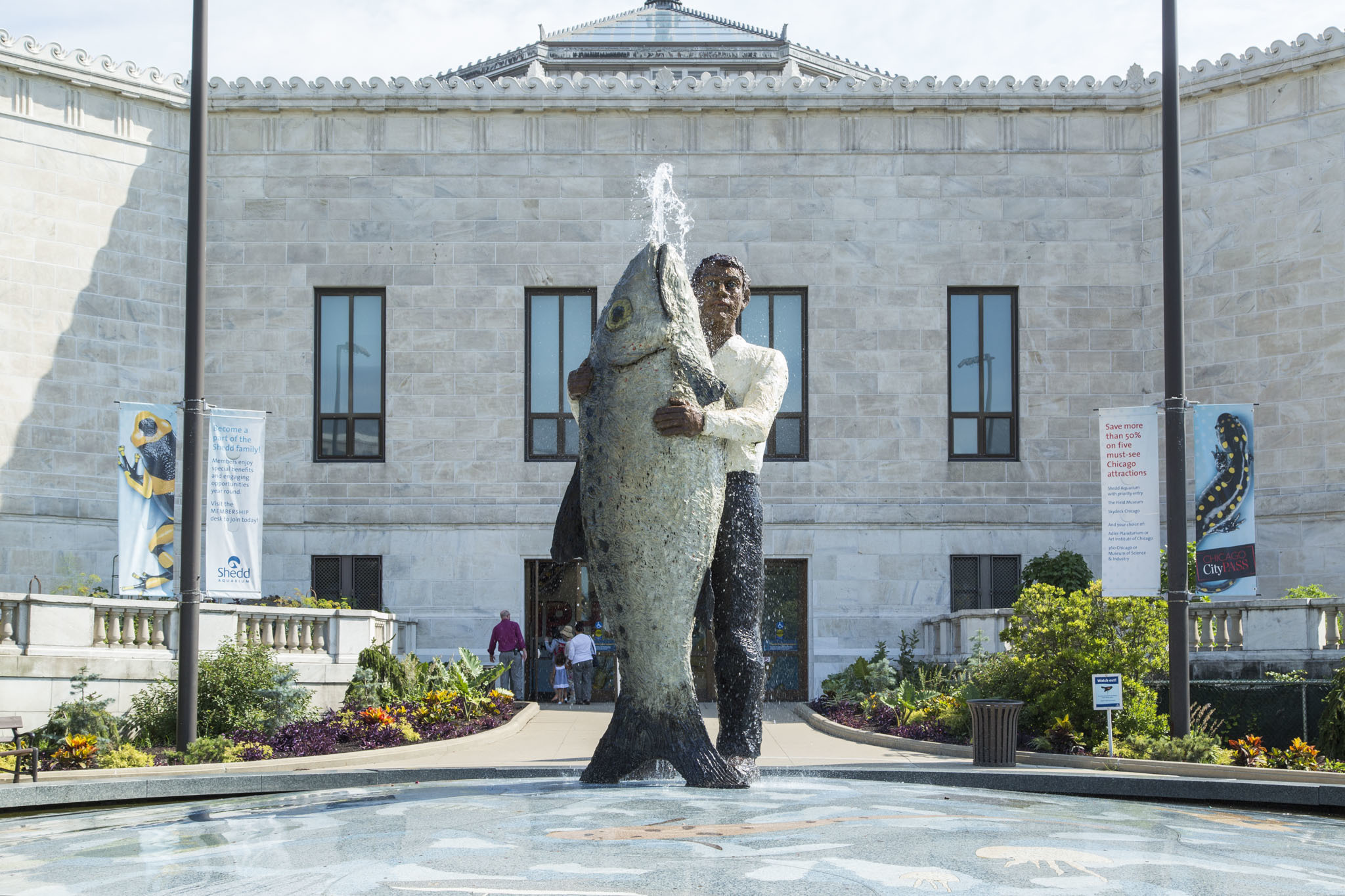 Man with Fish Sculpture