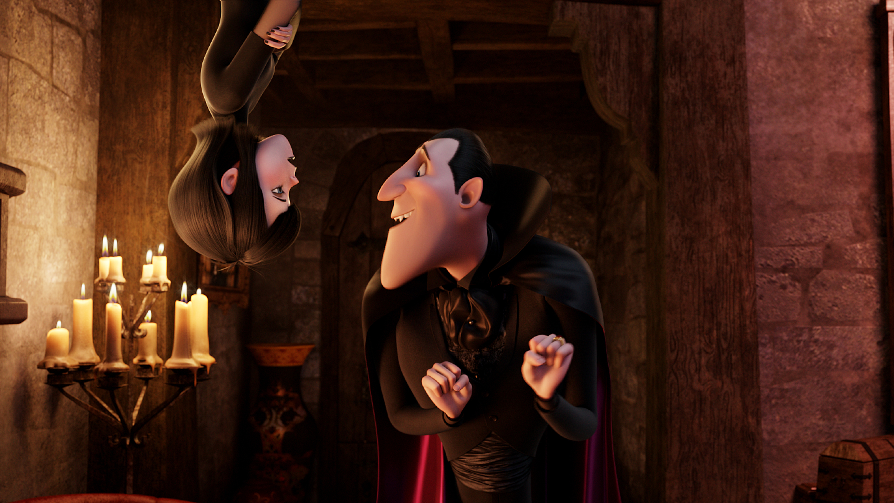 Mavis (Selena Gomez) and Dracula (Adam Sandler) i in HOTEL TRANSYLVANIA, an animated comedy from Sony Pictures Animation.